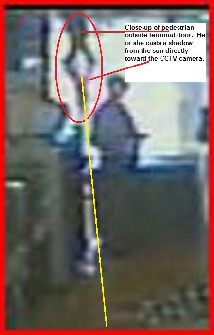 Edited Dulles Airport Pedestrian outside terminal casts very long shadow at 170 heading.jpg
